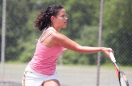 Image of a female tennis player hitting the ball
